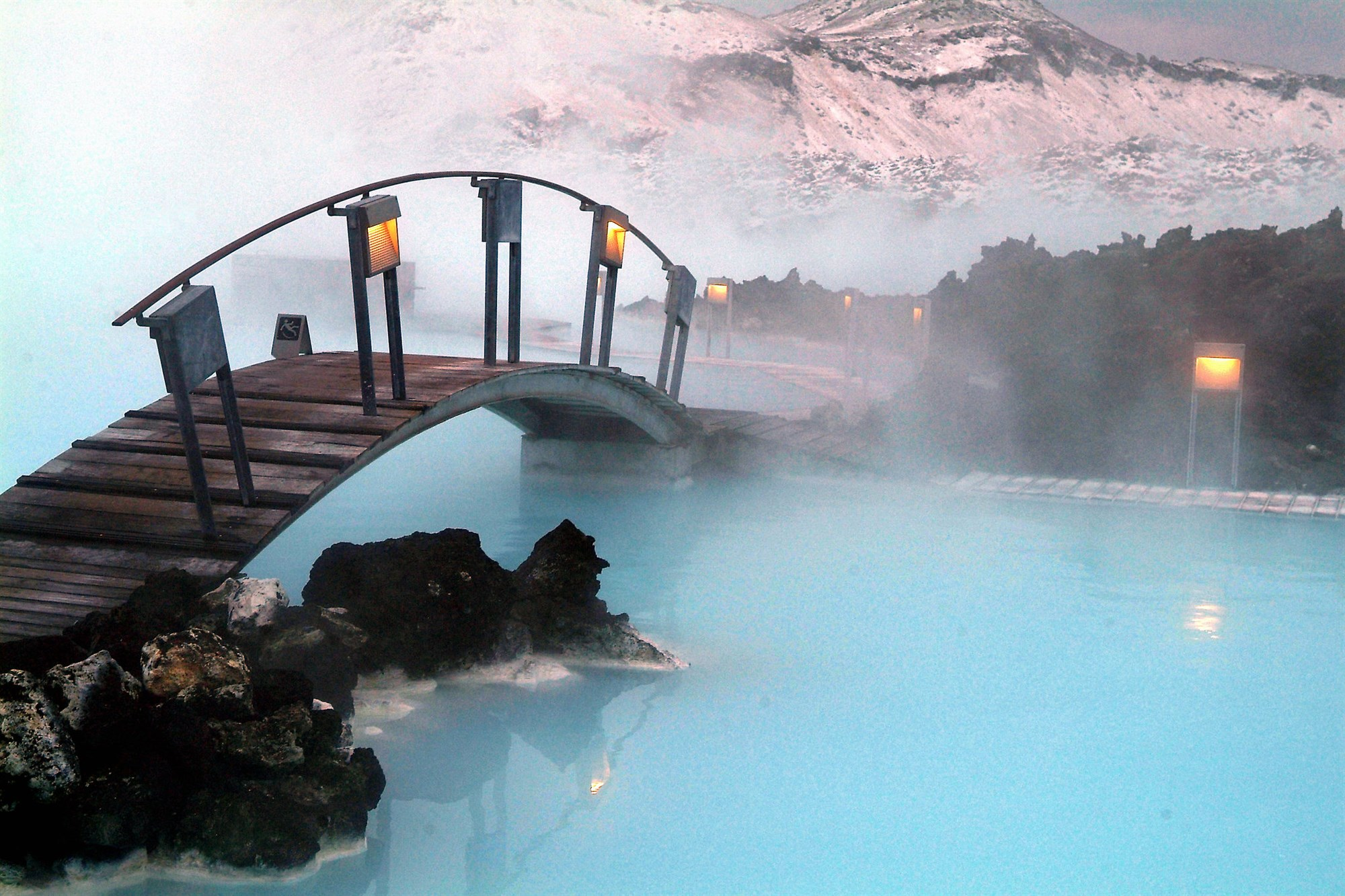 Blue lagoon iceland, blue water with a wooden bridge