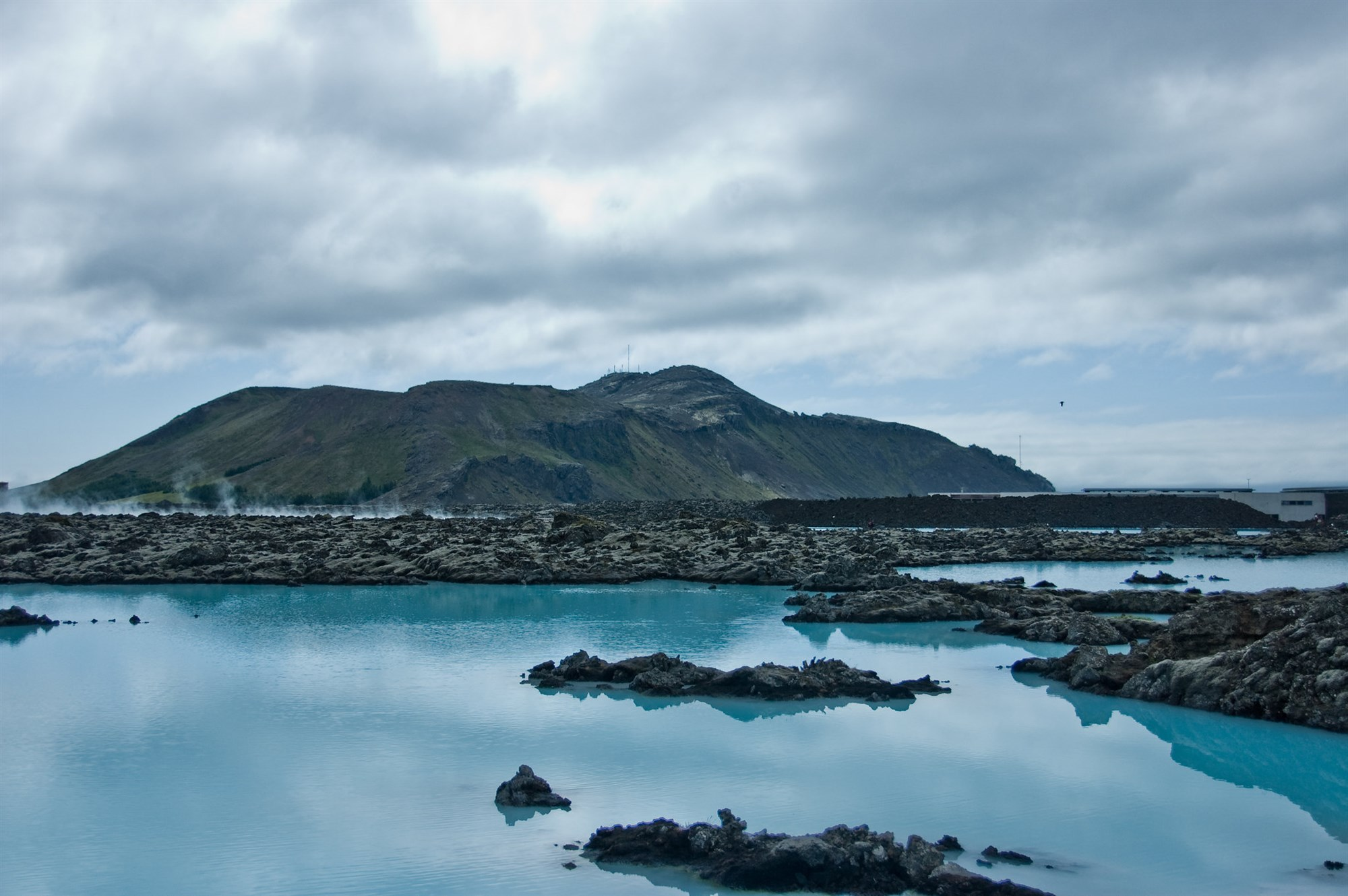 Blue Lagoon in Iceland with mountains on the background