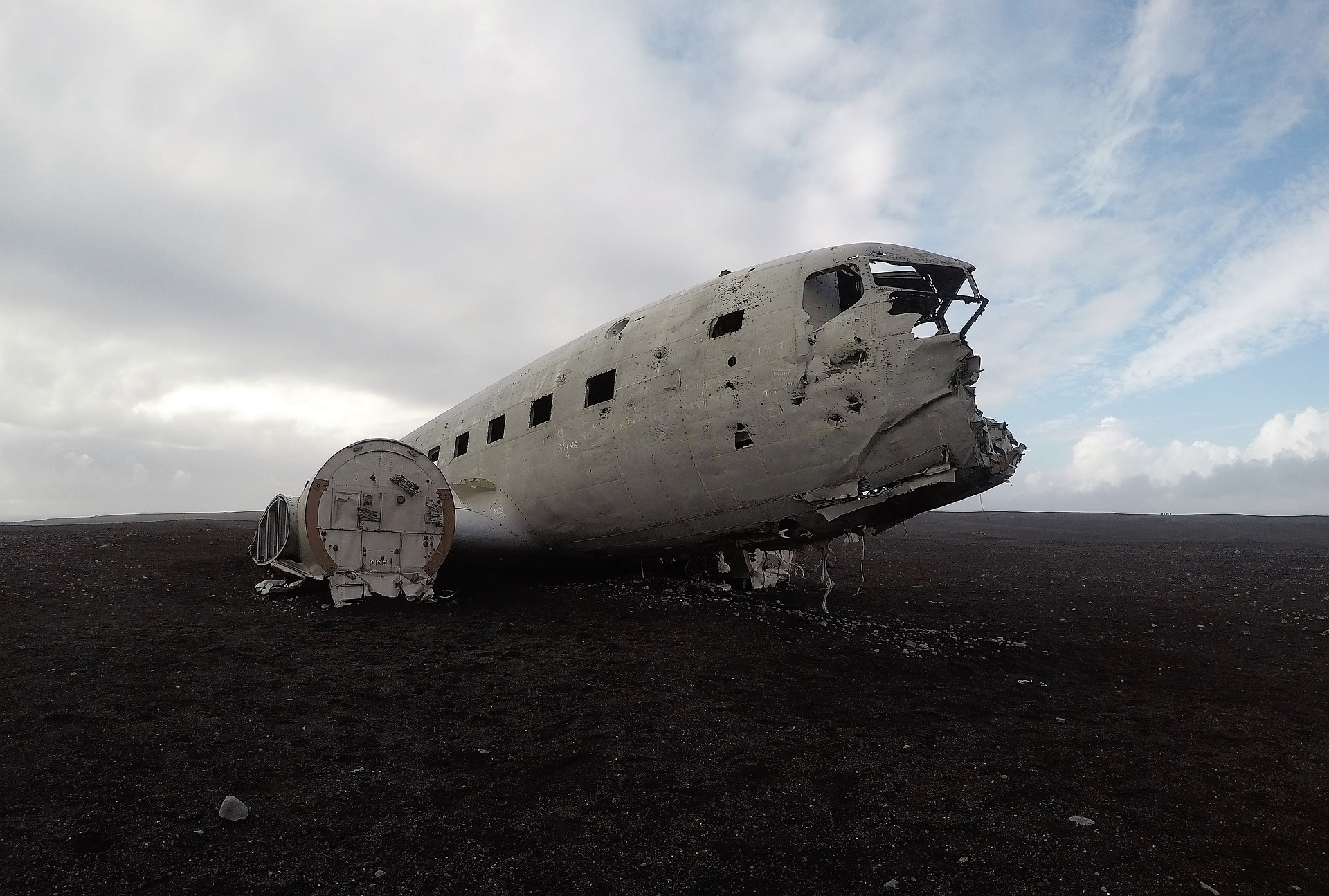 Solheimasandur plane wreck in Iceland, blue and grey sky, black sand