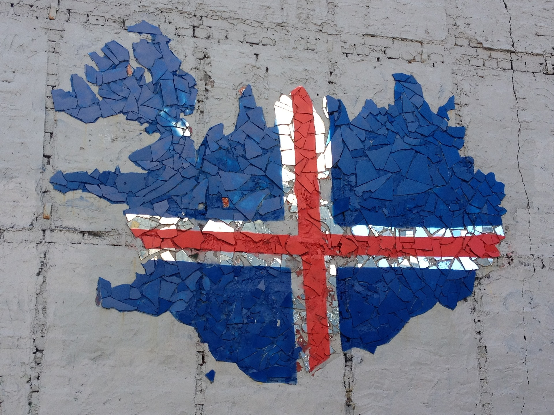 street art representing the icelandic flag on a wall in Reykjavik Iceland